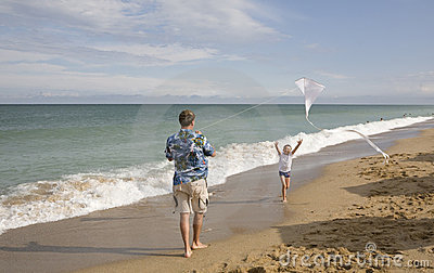 The father with the son fly a kite