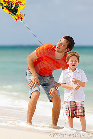 Father And Son Flying Kite Together Royalty Free Stock