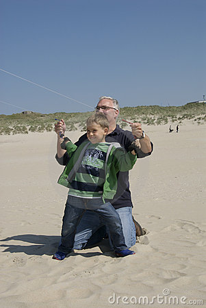 Father and son flying kites