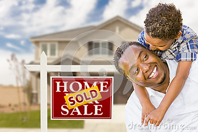 Father and Son In Front of Real Estate Sign, House