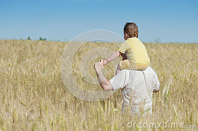 Father and son going in the field