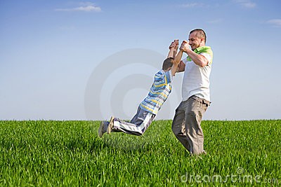 Father and son having good time outdoor