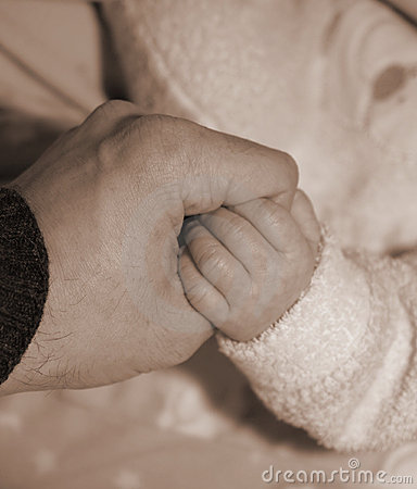 Father-and-Son Holding-Hands in an Act of Love