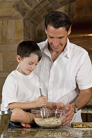 Father and Son In Kitchen Cooking Baking Cookies