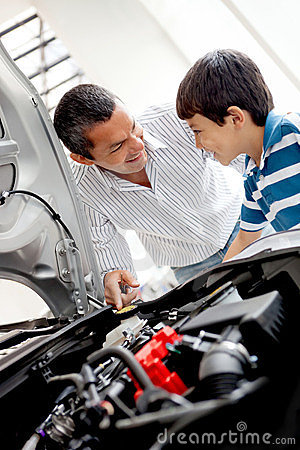 Father and son looking at car engine