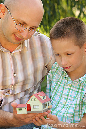 Father and son looking at wendy house