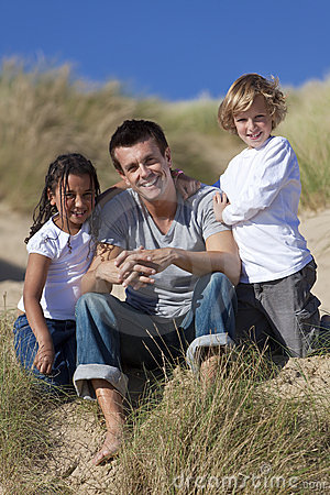 Father, Son & Mixed Race Daughter Sitting on Beach