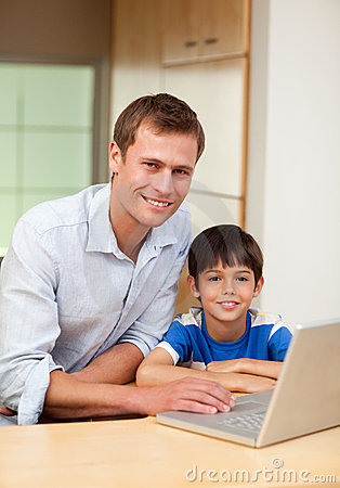 Father and son with notebook