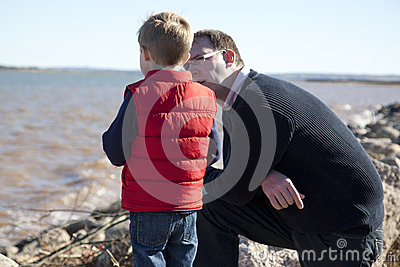 Father and son by the ocean