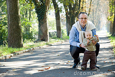 Father son outdoor park autumn