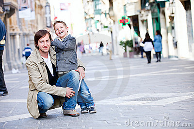 Father and son outdoors in city