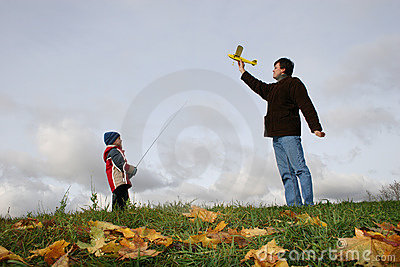 Father with son and plane