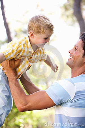 Father And Son Playing In Summer Garden