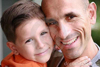 Father and son portrait smiling