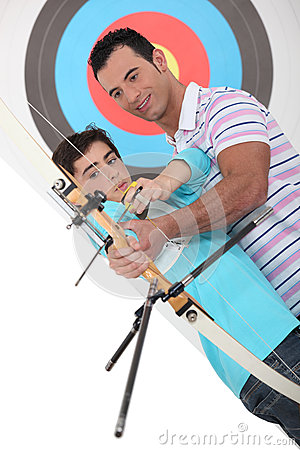 Father and son practising archery