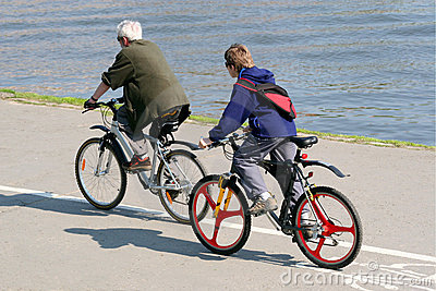 Father and son are riding on mountain bicycles