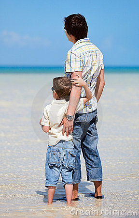 Father and son at shallow water