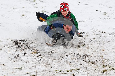 Father and son on sledge