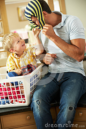 Father And Son Sorting Laundry