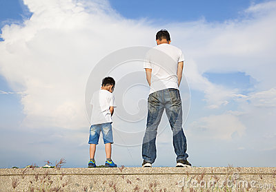 father and son standing on a stone platform and pee together stock photo image 43514792. Black Bedroom Furniture Sets. Home Design Ideas
