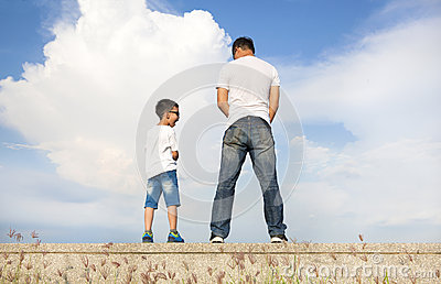 father and son standing on a stone platform and pee. Black Bedroom Furniture Sets. Home Design Ideas