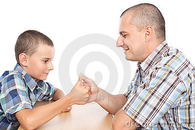 Father and son thumb wrestling