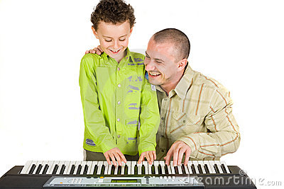 Father and son trying to play piano