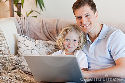 Father and son using notebook