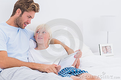 Father and son using a tablet together