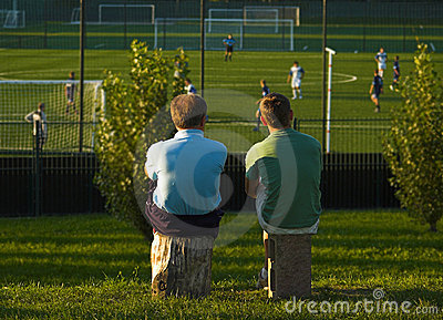 Father And Son Watching Younger One's Game