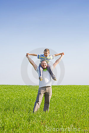 Father and son in a wheat field