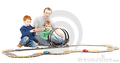 Father and sons playing kids racing toy car game
