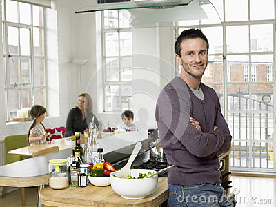 Father Standing Arms Crossed At Kitchen Counter