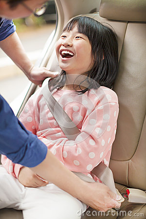Free Father Take Care Daughter To Fasten A Seat Belt Royalty Free Stock Image - 38965126