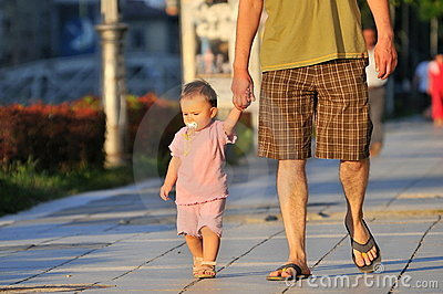 Father takes child for walk