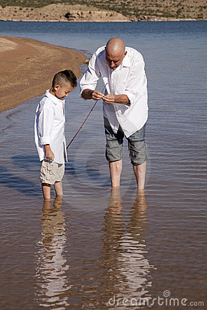 Father teach son to fish