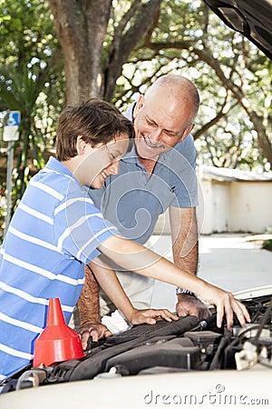 Father Teaches Son to Fix Car