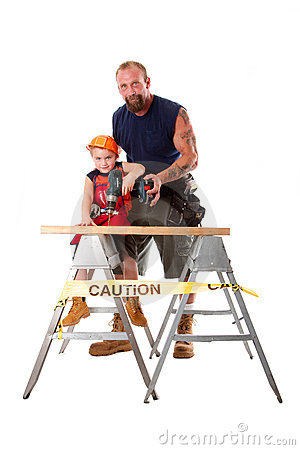 Father teaching son drilling