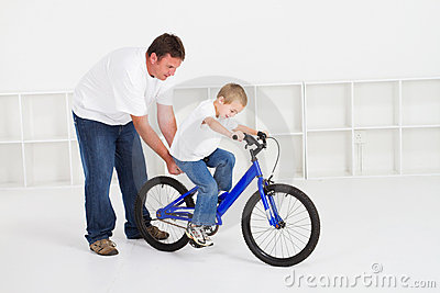 Father teaching son to ride