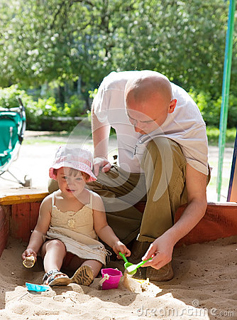 Father with  toddler   in sandbox