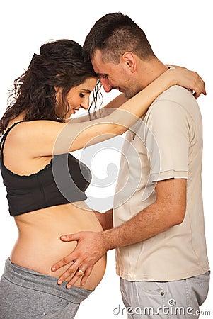 Father touching pregnant tummy