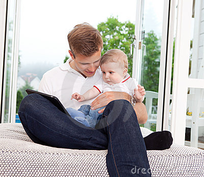 Father Using Digital Tablet with Son