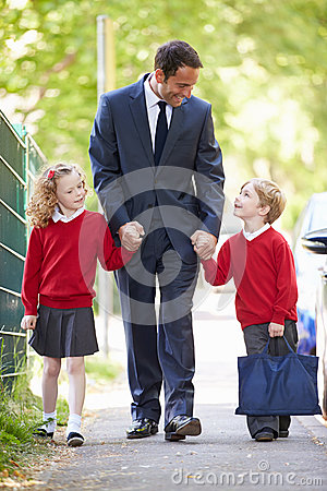 Free Father Walking To School With Children On Way To Work Royalty Free Stock Image - 35614876
