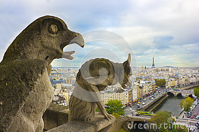 Faymous gargoyles of Notre Dame over Paris