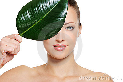 Feamle face covering with a green leaf
