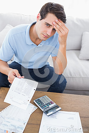 Free Fearful Man Doing His Accounts With A Calculator Royalty Free Stock Photography - 32513897