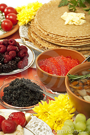 Feast table: pancake with different dishes