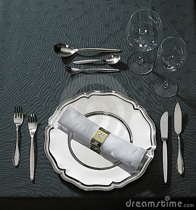 Feastful place setting on green tablecloth