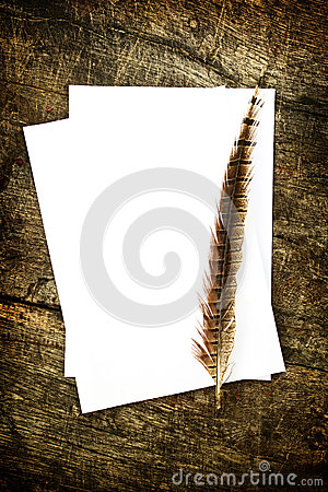 Feather and blank paper