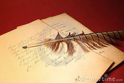 Feather on old papers